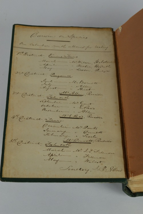 The inside cover of On the Origin of Species contains handwritten instructions and an agenda.