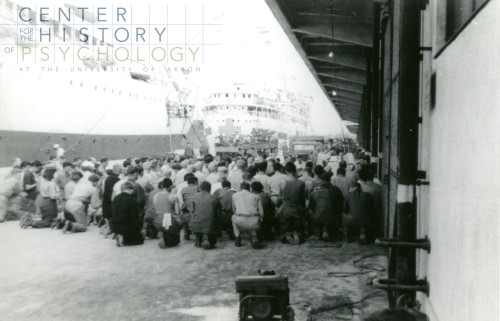 """written on back of photograph: """"Docked in Yokosuka @ Announcement of end of War. I held prayers of thanks for our crew AH-13 and other ships docked 8-6-45"""""""