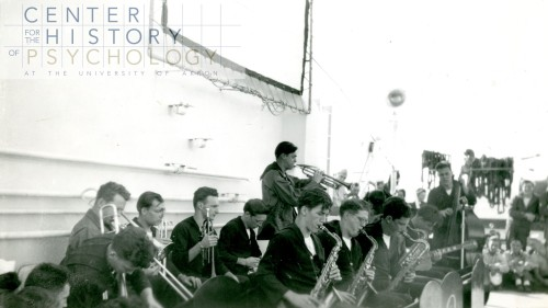 """written on back of photograph: """"USS Benevolence Band (14 piece); RSW organized, got instruments donated while in Brooklyn Shipyard. We played in/out of every port and many special occasions underway."""""""