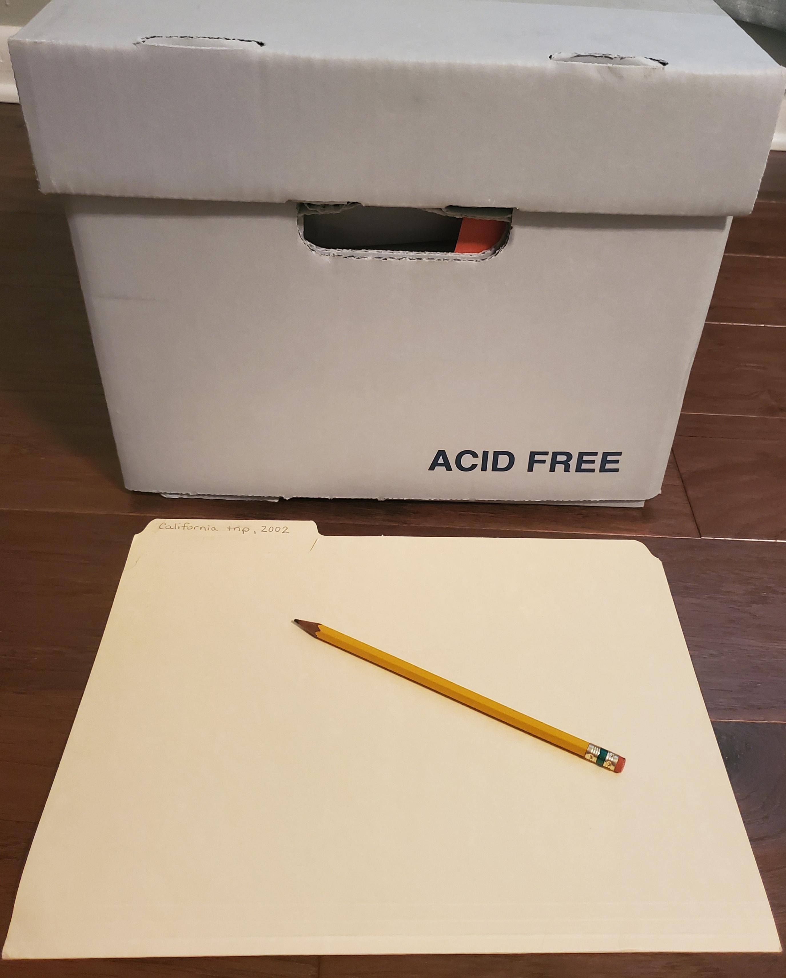 Acid free box, folder, and pencil